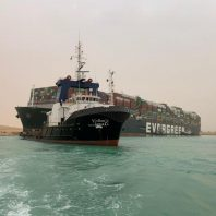 Suez Canal steps up efforts to remove blockage as shipping rates surge, tankers diverted away