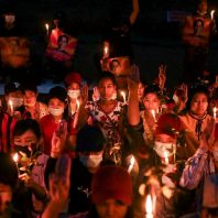 Myanmar protesters hold vigils as U.S. orders non-essential staff to leave