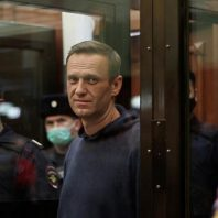 Russia detains Alexei Navalny allies, raids offices on eve of protest